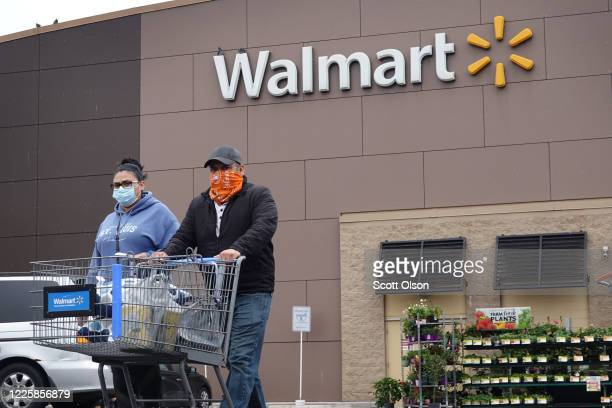 Customers shop at a Walmart store on May 19, 2020 in Chicago, Illinois. Walmart reported a 74% increase in U.S. Online sales for the quarter that...