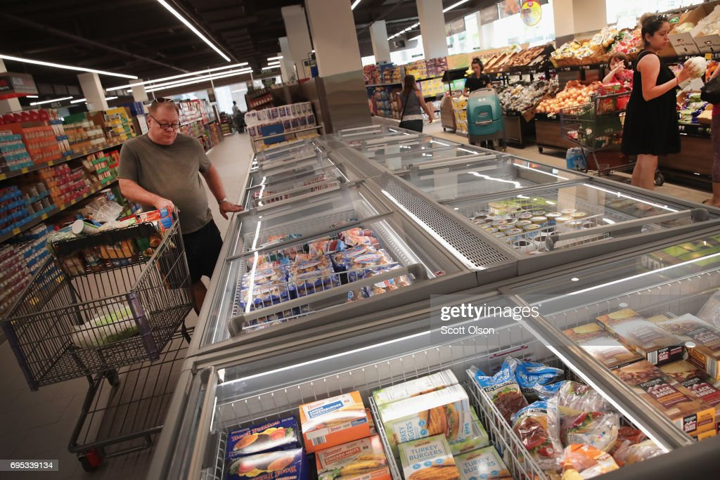 Customers shop at an Aldi grocery store on June 12, 2017 in