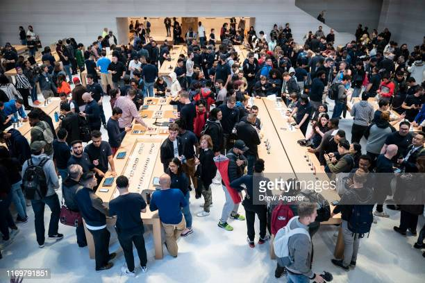 Customers shop at Apple's flagship 5th Avenue store on September 20, 2019 in New York City. Apple's new iPhone 11 goes on sale today at the grand...