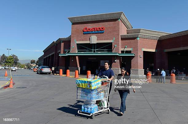 Customers shop at Costco on March 12 2013 in Los Angeles California Costco Wholesale Corp's profit beat expectations with a net income for the second...