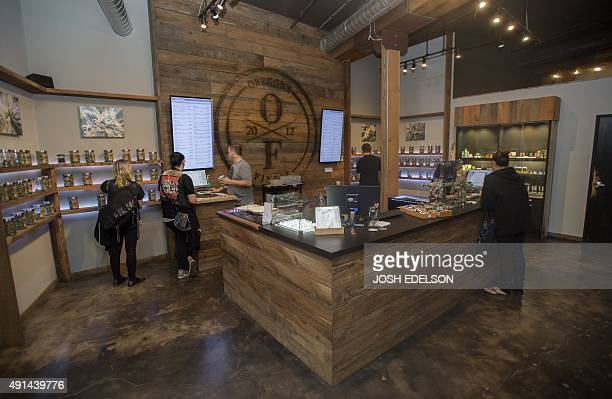 Customers shop at Oregon's Finest a marijuana dispensary in Portland Oregon on October 4 2015 As of October 1 2015 a limited amount of recreational...