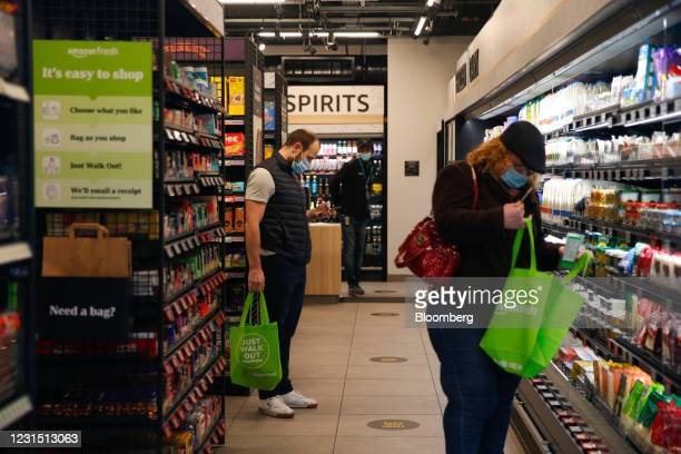 Customers shop at the Amazon.com Inc. Amazon Fresh cashierless convenience store in the Ealing area of London, U.K., on Thursday, March 4, 2021. The...