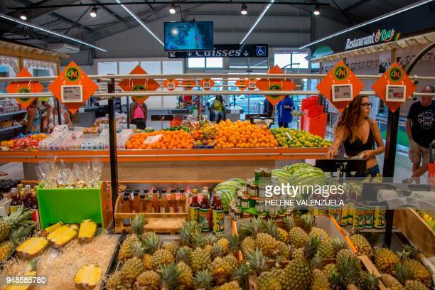 Customers shop at the fruit and vegetable department of an 'O Marche' supermarket in SaintFrancois on the French overseas territory of Guadeloupe on...