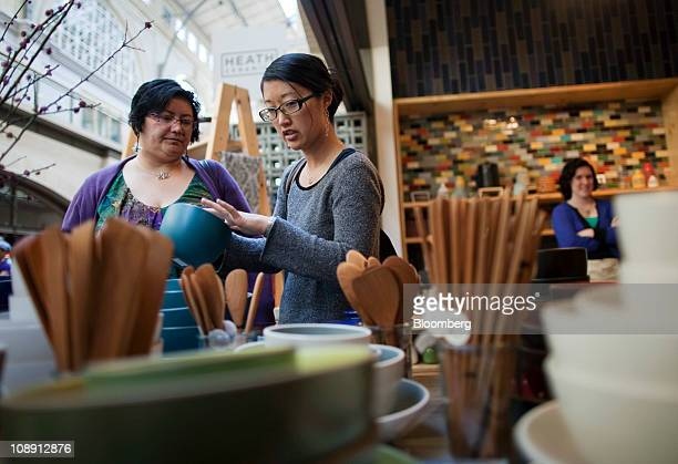Customers shop at the Heath Ceramics Ltd store at the Ferry Building in San Francisco California US on Saturday Feb 5 2011 Robin Petravic and his...