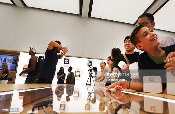 Customers shop at the new Apple Store at the 350000 squarefoot World Trade Center shopping mall at the Oculus on opening day on August 16 2016 in New...