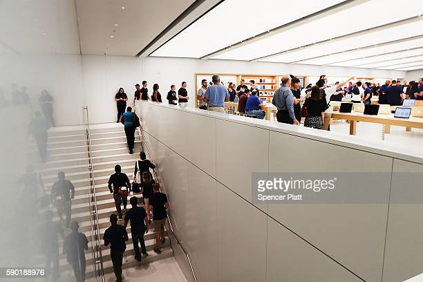 Customers shop at the new Apple Store at the 350000 squarefoot Westfield World Trade Center shopping mall at the Oculus on opening day on August 16...