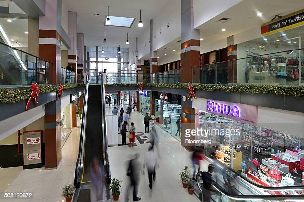 Customers shop at the Spar shopping mall in Port Harcourt Nigeria on Tuesday Jan 12 2016 With his security forces engaged in fighting Boko Haram's...