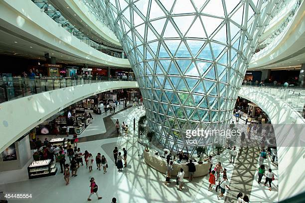 Customers shop at the world's largest dutyfree store on Semptember 1 2014 in Sanya Hainan province of China The world's largest dutyfree shop with a...