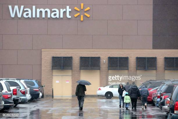Customers shop at Walmart store on January 11 2018 in Chicago Illinois Walmart announced today it would use savings from the recently revised tax law...