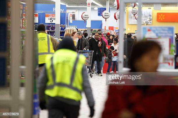 Customers shop at WalMart Thanksgiving day on November 28 2013 in Troy Michigan Black Friday shopping began early this year with most major retailers...