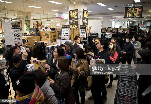Customers shop during the Black Friday sale at an Aeon supermarket on November 25 2016 in Tokyo Japan Japan's largest retailer Aeon held the Black...