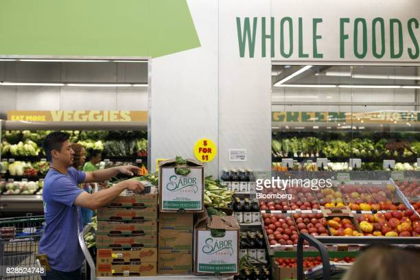 Customers shop during the grand opening of a Whole Foods Market 365 location in Santa Monica California US on Wednesday Aug 9 2017 The fifth Whole...