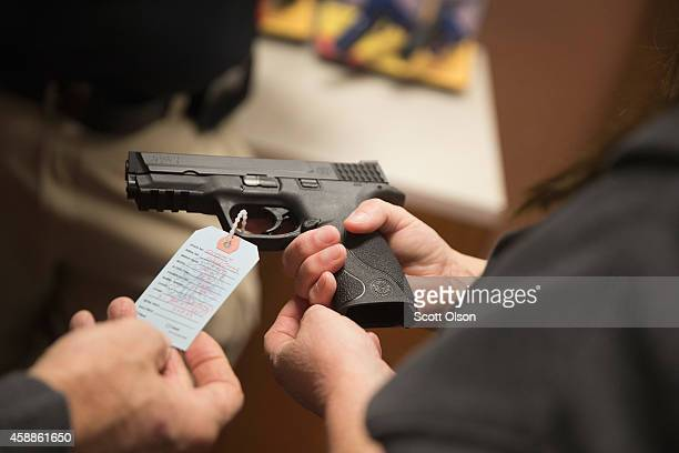 Customers shop for a handgun at Metro Shooting Supplies on November 12, 2014 in Bridgeton, Missouri. The suburban St. Louis store is located near...