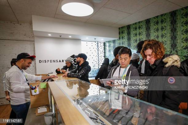 Customers shop for a recreational marijuana at Dispensary 33 store on January 1 2020 in Chicago Illinois On the first day of 2020 recreational...