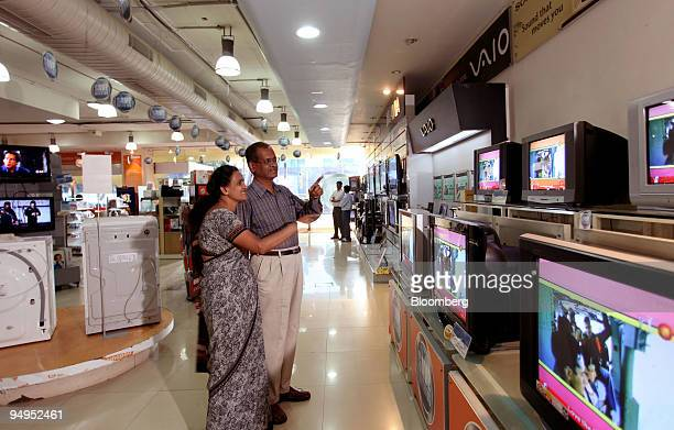 Customers shop for a television at an eZone retail showroom in the Jayanagae area in Bangalore India on Saturday Aug 29 2009 India's economic growth...
