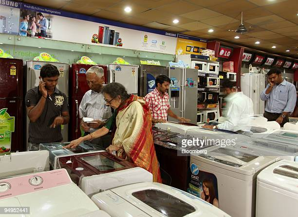 Customers shop for a washing machine at a Devi International store in Bangalore India on Saturday Aug 29 2009 India's economic growth probably...