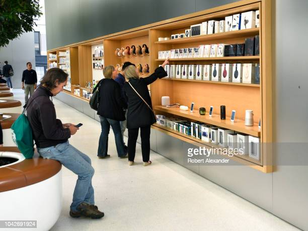 SAN FRANCISCO CALIFORNIA SEPTEMBER 12 2018 Customers shop for accessories at the Apple Store in San Francisco California's Union Square