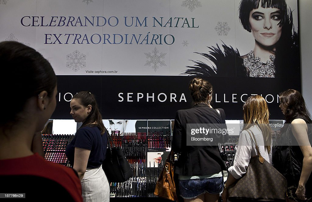 Customers shop for beauty products during the opening of a Sephora SA store at the Riosul shopping mall in Rio de Janeiro, Brazil, on Wednesday, Dec. 5, 2012. Sephora SA, a French beauty product retail chain, opened its first Brazil location earlier this year in July. Photographer: Dado Galdieri/Bloomberg via Getty Images