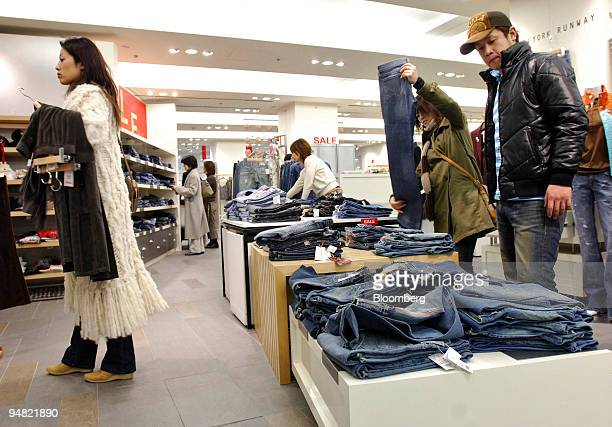 Customers shop for clothes at a Mitsukoshi department store in the Ginza district of Tokyo Friday, January 13, 2006.