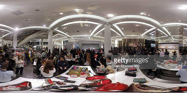 Customers shop for cut price items in Selfridges during the Boxing Day sales on December 26 2015 in London England Boxing Day is one of the busiest...
