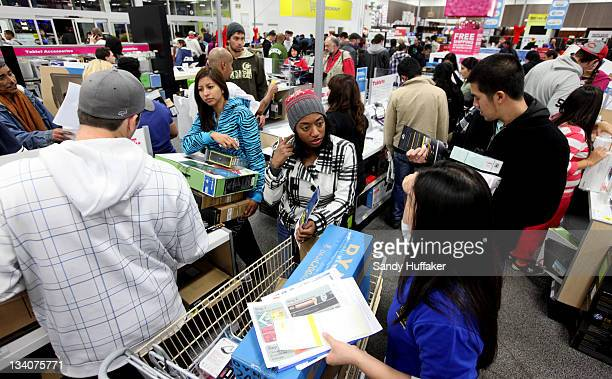 Customers shop for electronics items during 'Black Friday' at a Best Buy store on November 25 2011 San Diego California Thousands of consumers are...