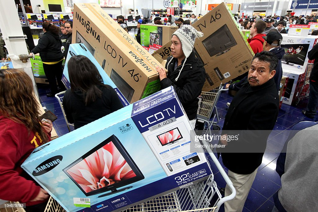 Customers shop for electronics items during 'Black Friday' at a Best Buy store on November 25, 2011 San Diego, California. Thousands of consumers are queuing at various stores across the nation to take advantage of 'Black Friday' deals as the holiday shopping season begins in America.