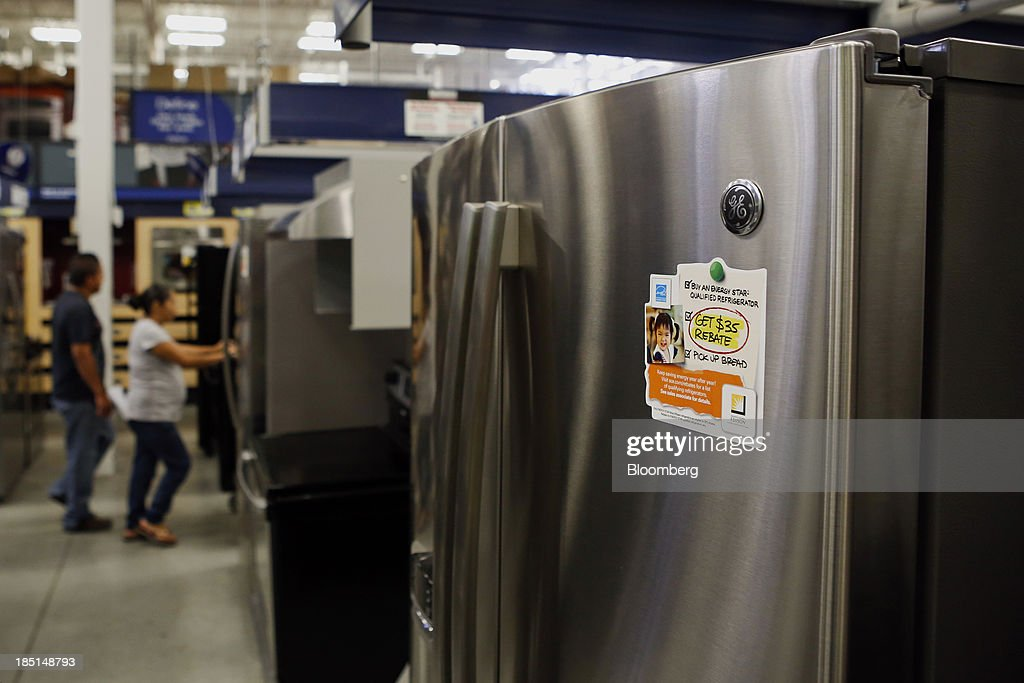 Customers shop for General Electric Co. (GE) refrigerators at a Lowe's Cos. store in Torrance, California, U.S, on Thursday, Oct. 17, 2013. General Electric Co. is scheduled to release earnings figures on Oct. 18. Photographer: Patrick T. Fallon/Bloomberg via Getty Images