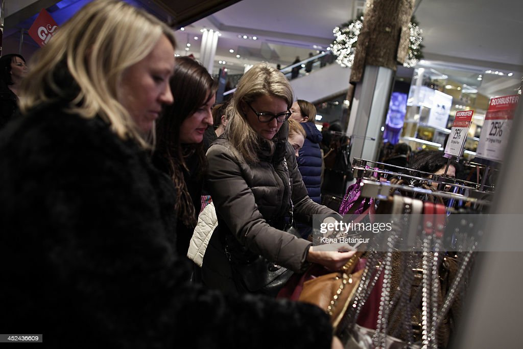 Customers shop for handbags at Macy's Herald Square after the store opened its doors at 8 pm Thanksgiving day on November 28, 2013 in New York City. Black Friday shopping began early again this year with most major retailers opening their doors on Thanksgiving day.