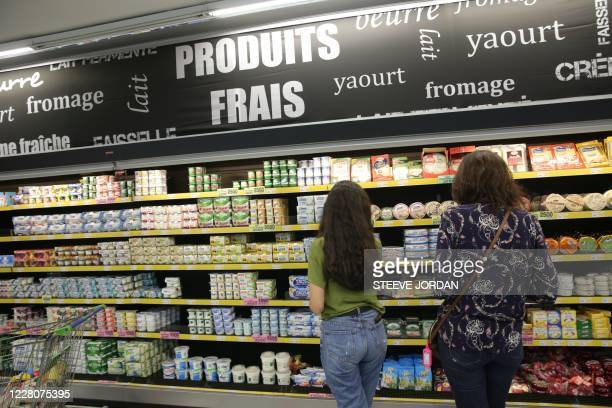 Customers shop for imported goods, mainly from France, at a supermarket in Libreville on August 10, 2020. - Gabon celebrates 60 years of independence...