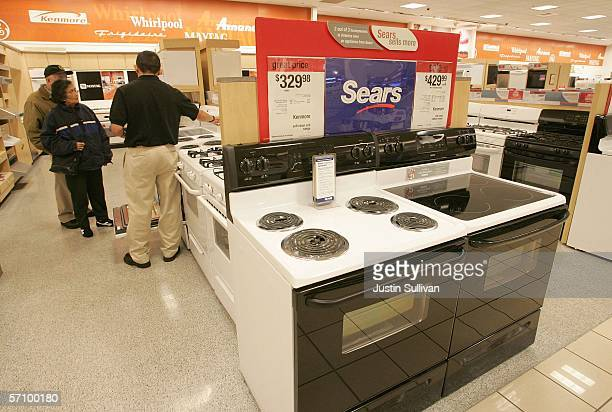 Customers shop for kitchen appliances at a Sears store March 15 2006 in San Bruno California Sears Holdings Corp announced a higherthanexpected...