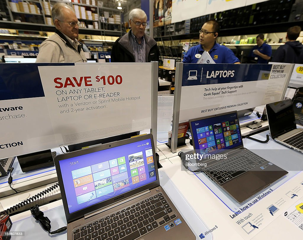 Customers shop for laptops running Microsoft Corp. Windows 8 operating systems at a Best Buy Co. store in Orem, Utah, U.S., on Friday, Oct. 26, 2012. Microsoft Corp. introduced the biggest overhaul of its flagship Windows software in two decades, reflecting the rising stakes in its competition with Apple Inc. and Google Inc. for the loyalty of customers who are shunning personal computers and flocking to mobile devices. Photographer: George Frey/Bloomberg via Getty Images
