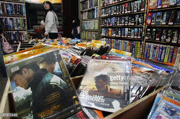 Customers shop for pirate DVDs on April 20 2006 in Wuhan of Hubei Province China Chinese Premier Wen Jiabao has reiterated his confidence in China's...