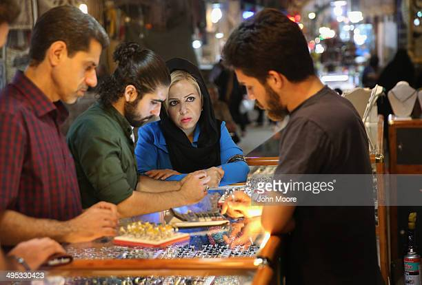 Customers shop for silver jewelry in the historic Bazare Bozorg on June 2 2014 in Isfahan Iran Gold jewelry vendors are on strike protesting the...