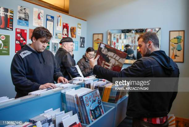 Customers shop for special edition vinyl records at Dusty Groove music store during the Record Store Day in Chicago on April 13 2019 Record Store Day...
