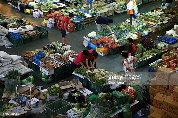 Customers shop for vegetables at Noeun Agricultural and Marine Products Wholesale Market in Daejeon, South Korea, on Tuesday, July 16, 2013. South...