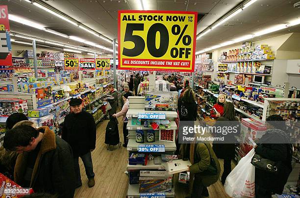 Customers shop in a branch of Woolworths in Camden on December 5 2008 in London England Retailers are discounting earlier than usual in the...