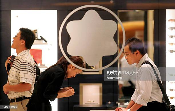 Customers shop in a Montblanc store in Taipei Taiwan on Wednesday Oct 3 2007 Taiwan's inflation probably accelerated to the fastest pace in almost...