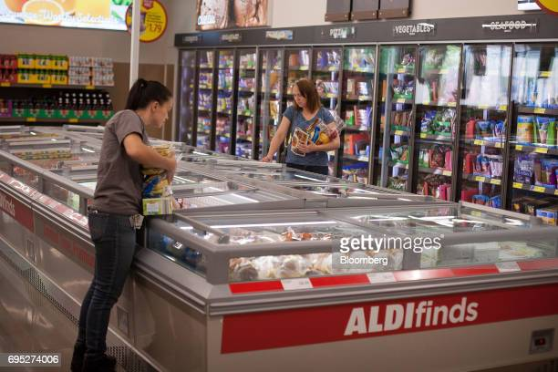 Customers shop in the frozen food section of an Aldi Stores Ltd location in Hackensack New Jersey US on Thursday June 8 2017 A decadeslong...