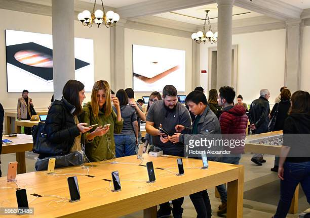 Customers shop in the new Apple Store which opened in Florence Italy in September 2015 It is located in the city's historic Piazza della Repubblica