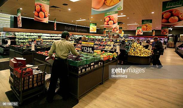 Customers shop in the produce section of a Woolworths Ltd supermarket in Melbourne Australia on Wednesday Jan 27 2010 Woolworths Ltd Australia's...