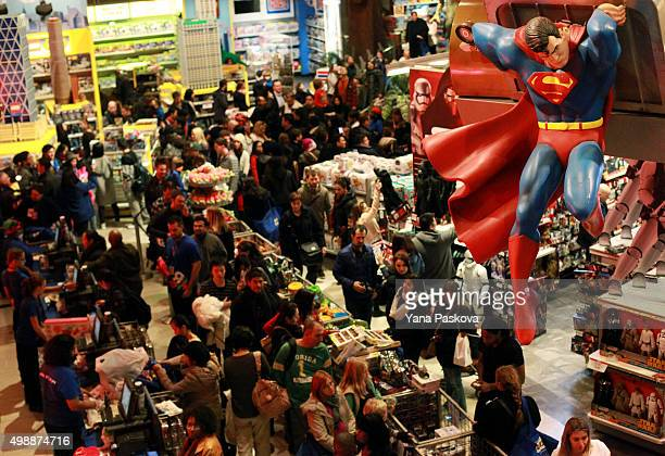 Customers shop in Toys R Us in Times Square on Thanksgiving evening for early Black Friday sales on November 26 2015 in New York City Security has...