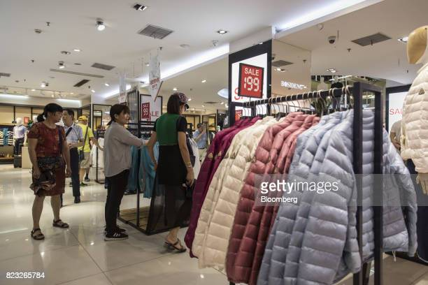 Customers shop inside the Bosideng International Holdings Ltd. Flagship clothing store in Shanghai, China, on Friday, July 14, 2017. Bosideng, a...