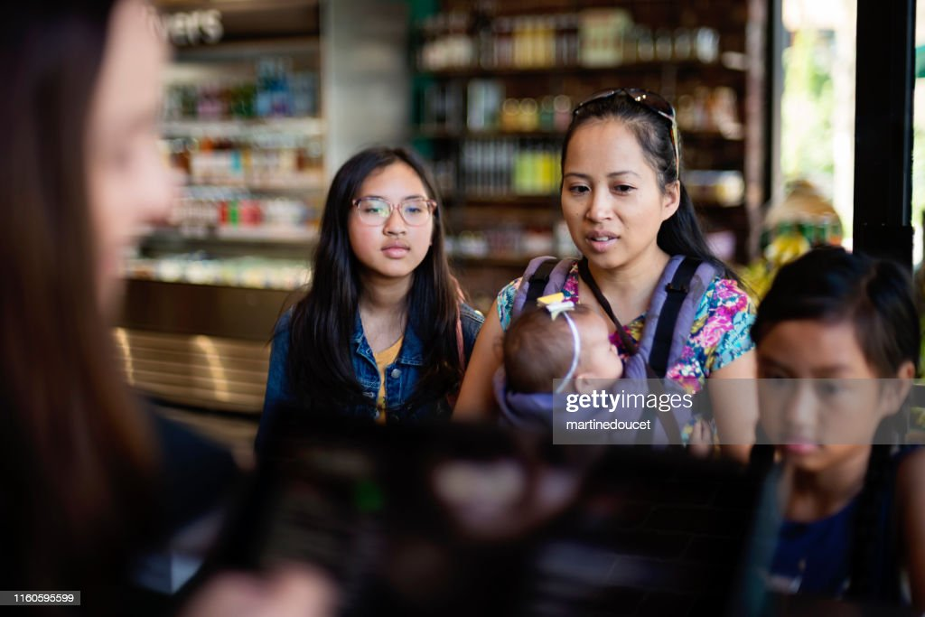Customers shopping in small zero waste oriented fruit and grocery store. : Stock Photo