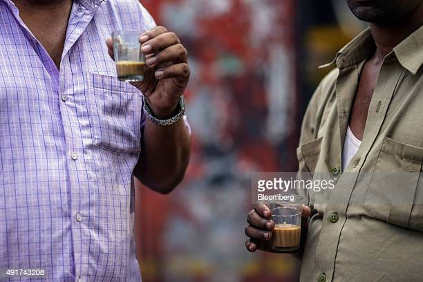 Customers sip glasses of chai at a roadside stall in Mumbai India on Friday Sept 25 2015 Chai the sweet milky tea concoction popular in most of South...