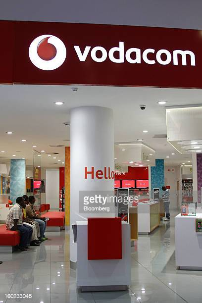 Customers sit and wait for service inside a Vodacom store at Vodaworld the headquarters of Vodacom Group Ltd Vodafone's biggest African business in...