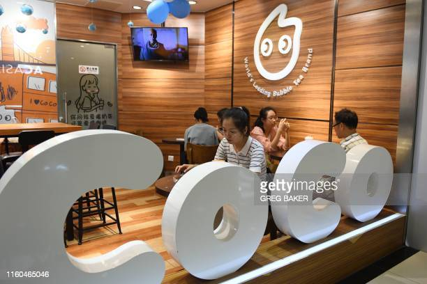 Customers sit at a Coco bubble tea outlet in Beijing on