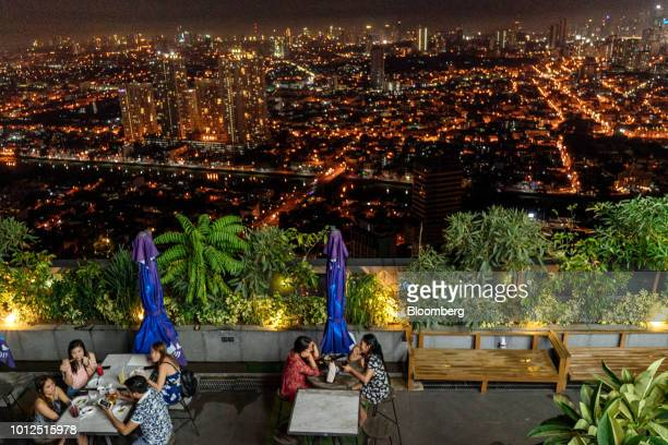Customers sit at a rooftop bar overlooking the Makati district of Manila the Philippines on Saturday Aug 4 2018 Consumer prices in the Philippines...