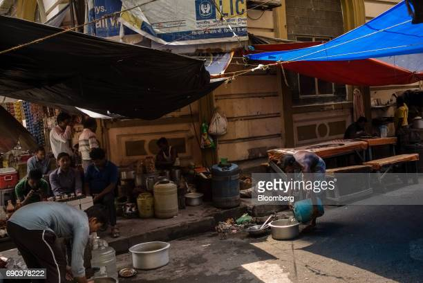 Customers sit at a tea stall outside the Life Insurance Corporation building in the BBD Bagh area of Kolkata India on Friday May 26 2017 India is...