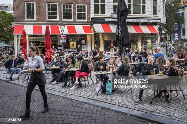Customers sit at a terrace on the Spui in Amsterdam on September 26, 2020 while the Amsterdam-Amstelland Safety Region is preparing new, stricter...