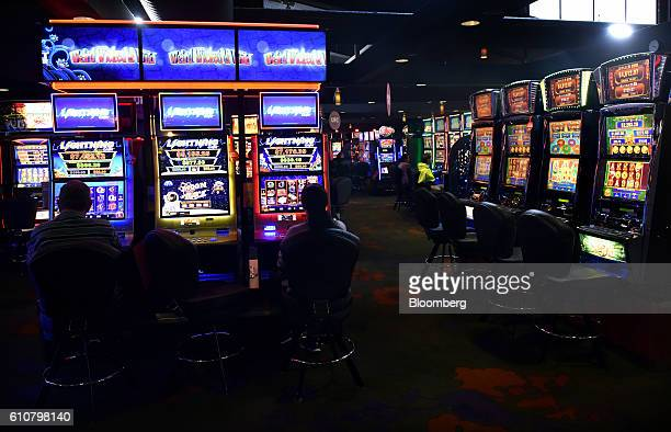 Customers sit at poker machines in the gaming room at the Vikings Club in Canberra Australia on Monday Sept 26 2016 Despite having less than half a...